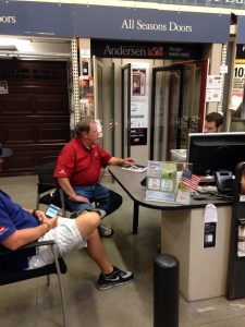 Here we see Bill at Home Depot ordering a new sliding glass door for one of his homeowners.