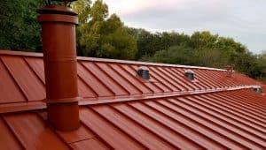 Red metal roof by Elite Roofing in Denver